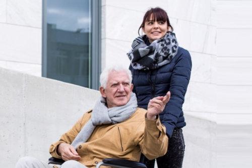 senior man with his female caregiver
