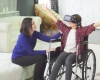 child on wheelchair experiencing virtual reality