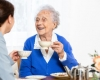 caregiver and senior woman are laughing
